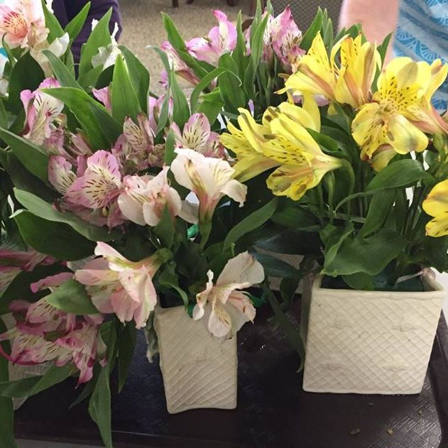 Arranging flowers for Mother's Day tables